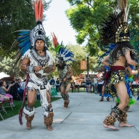 Students and families enjoy a performance by Aztec dancers at the Latino Education Access and Development Conference