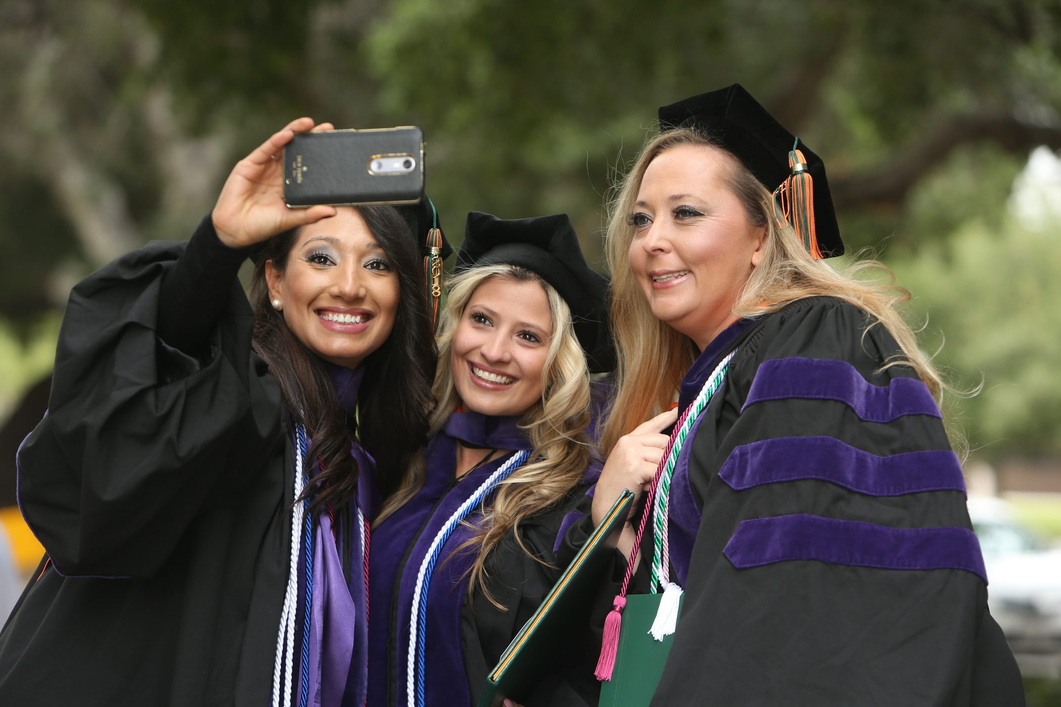 Students take photos at the 2018 College of Law Commencement ceremony.