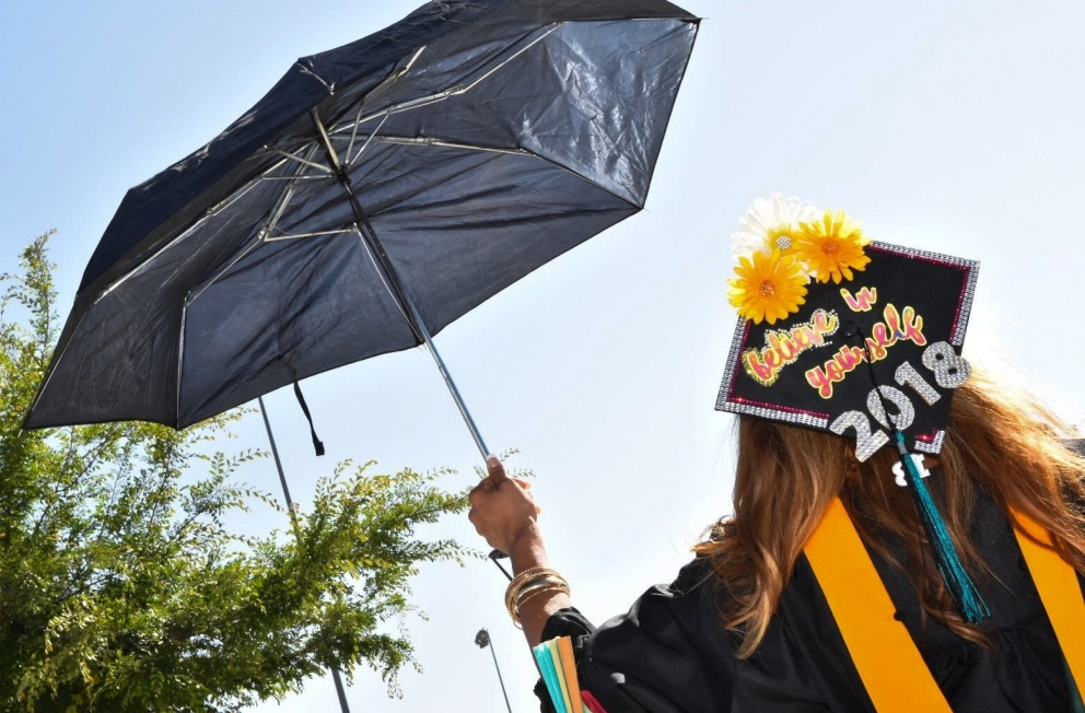 "Graduate at the 2018 Commencement Ceremony. Her cap says ""Believe in yourself 2018."""