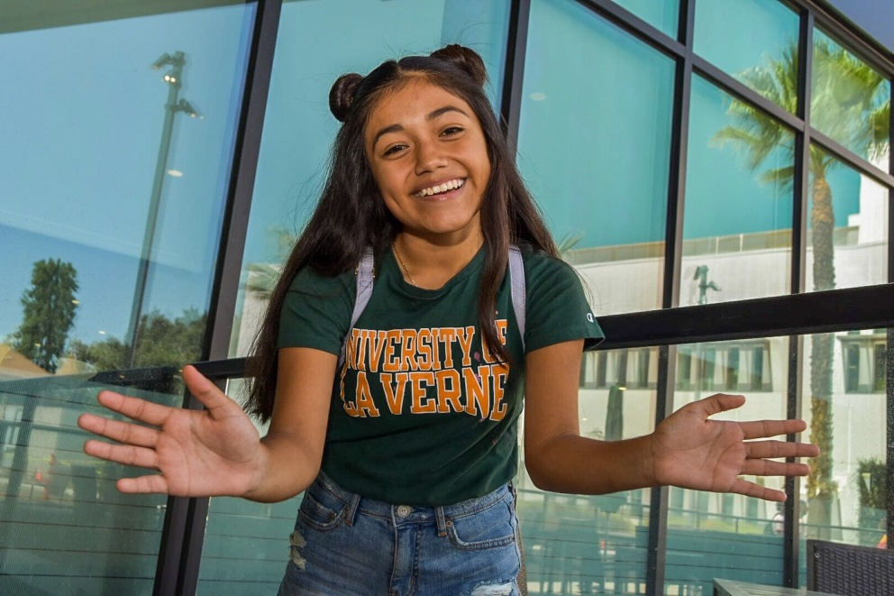Student smiles on move-in day