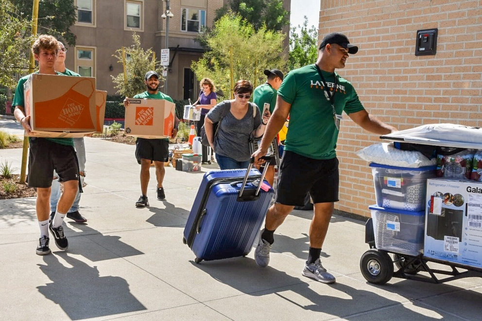 Students move in to their dorms.