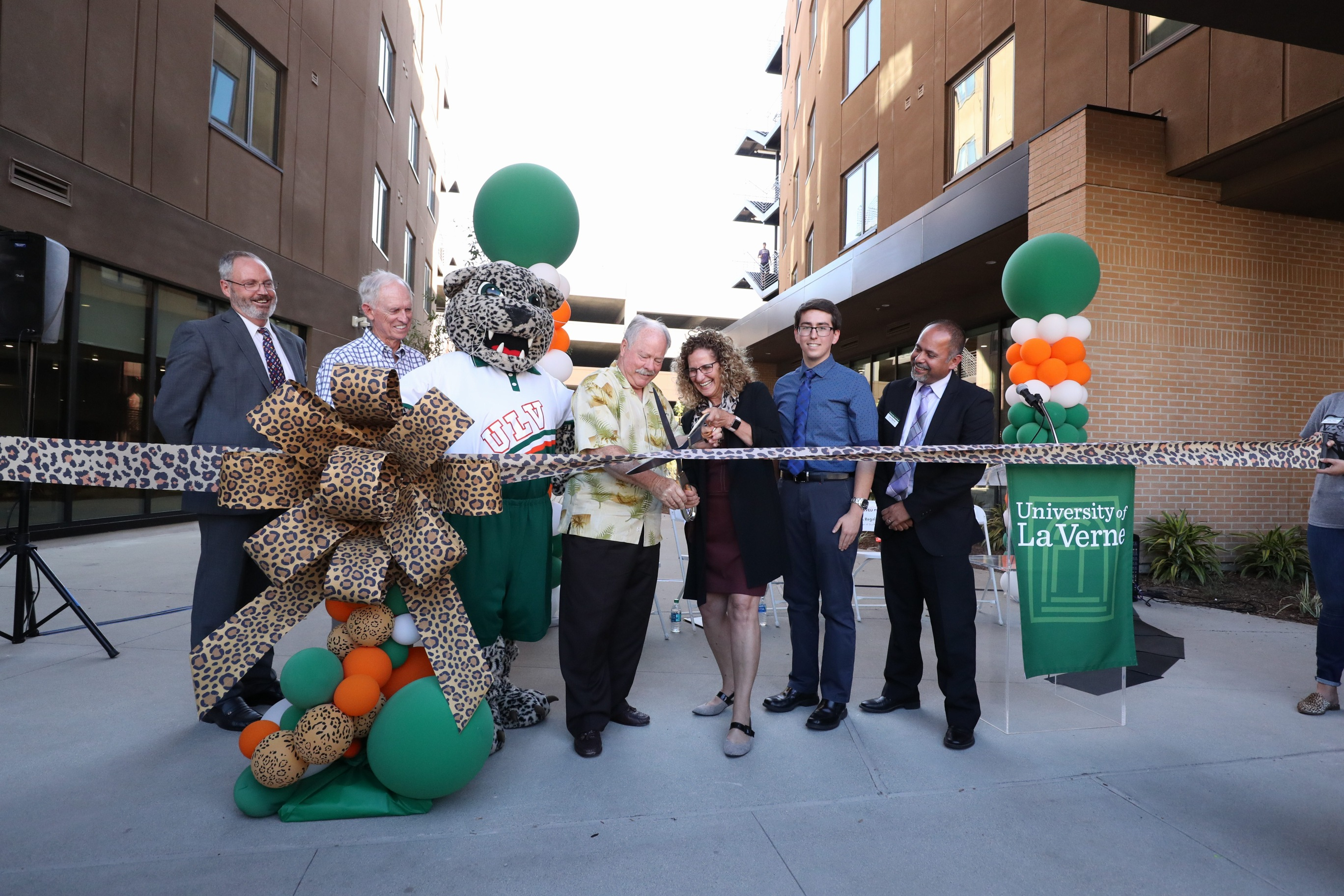 President Devorah Lieberman and La Verne Mayor Don Kendrick cut the ribbon at the grand opening celebration for Citrus Hall and The Spot at the University of La Verne.