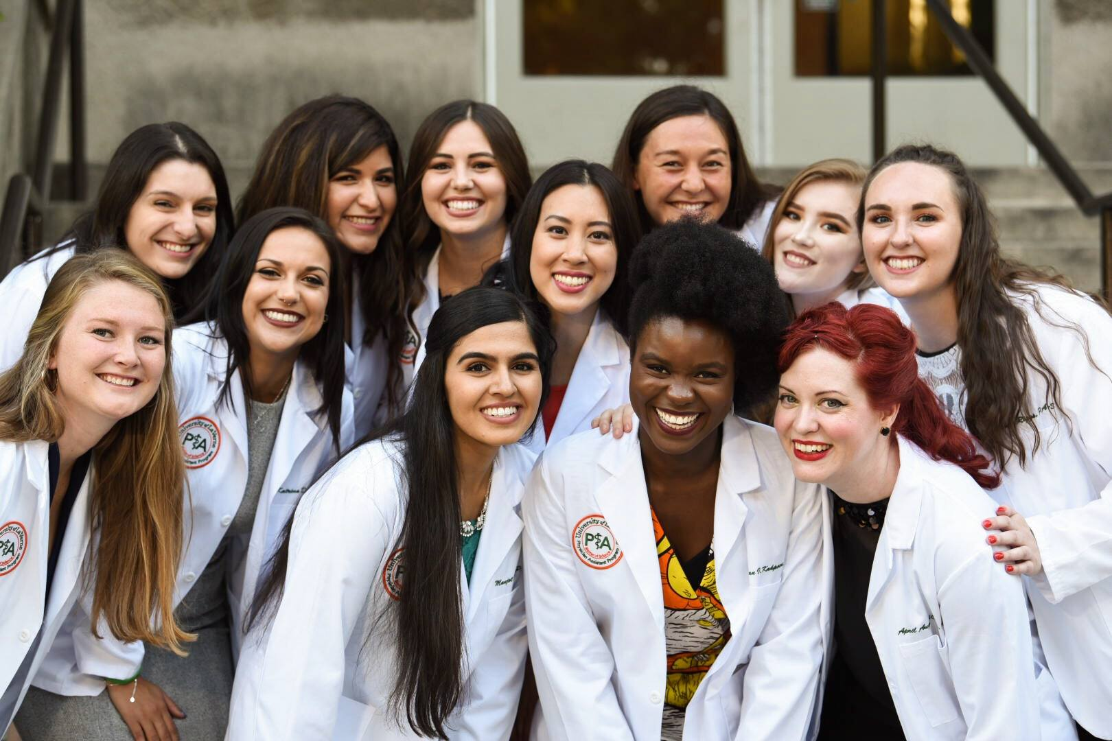 Students smile at the Physician's Assistant Program white coat ceremony.