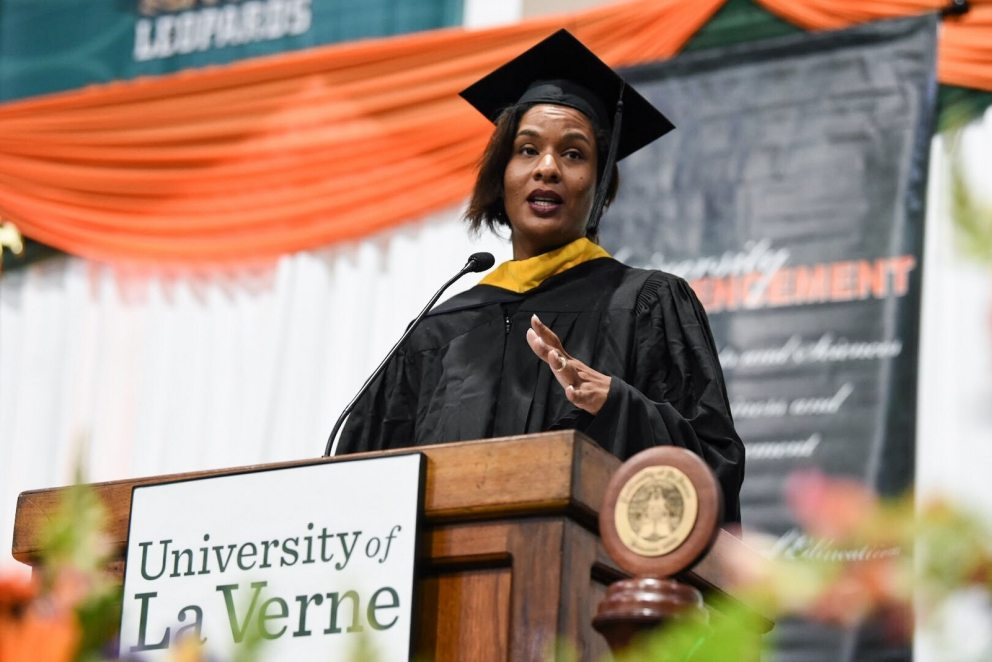 Kiana Webb, president of Webb Family Enterprises, speaks at commencement.
