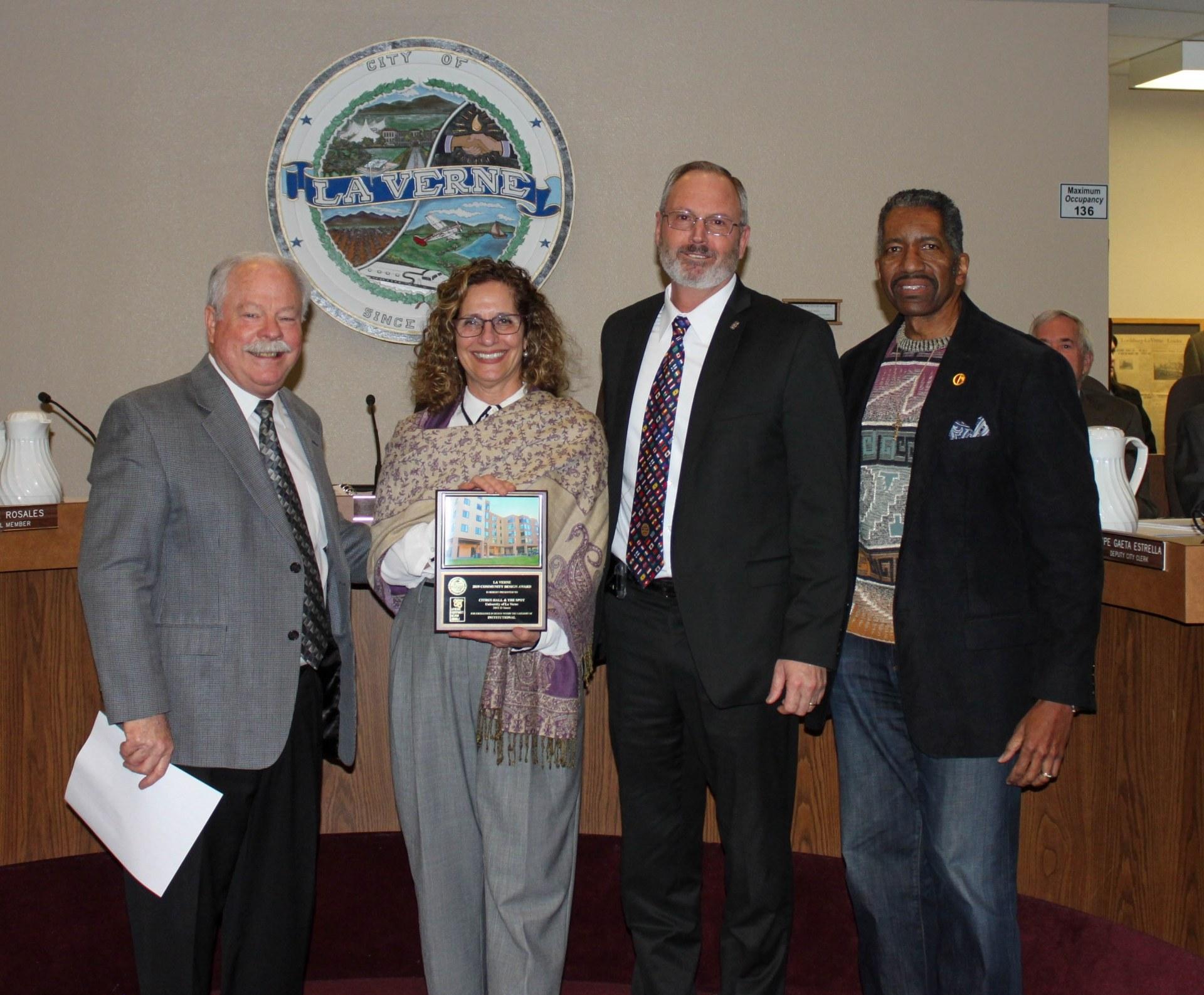 University President Devorah Lieberman poses with City of La Verne award