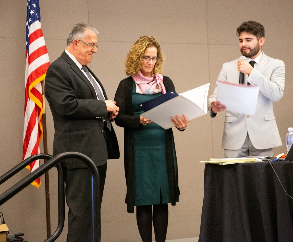 Dean Abe Helou and University President Devorah Lieberman accept certificates