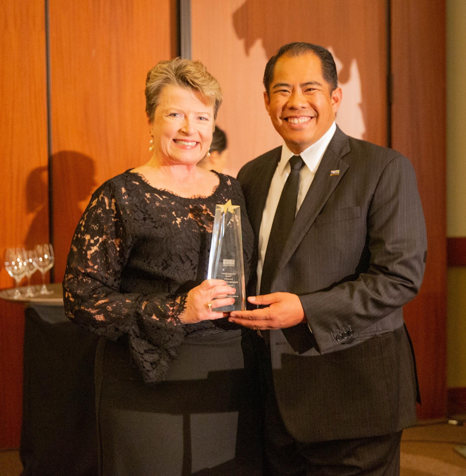 Sherri Mylott holding the Education Pioneer Award