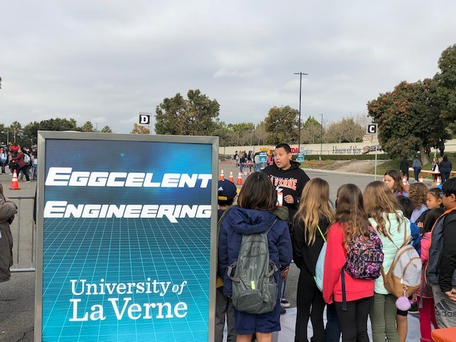 Students gathered at the University of La Verne booth