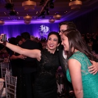 Board of Trustee Wendy Lau snaps a selfie with friends at the Scholarship Gala.