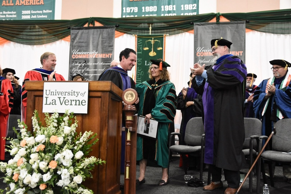 President Lieberman shakes guests' hands at commencement.