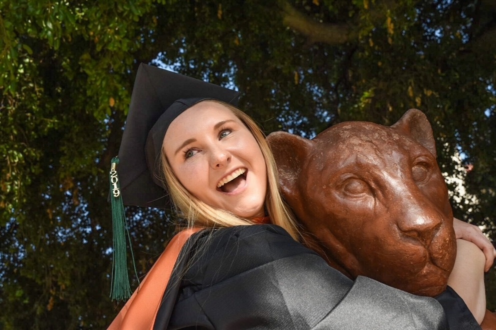 Female student hugging the mascot