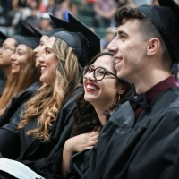 Students smiling at celebration