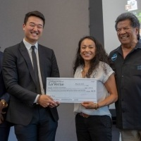 Students present check to charity