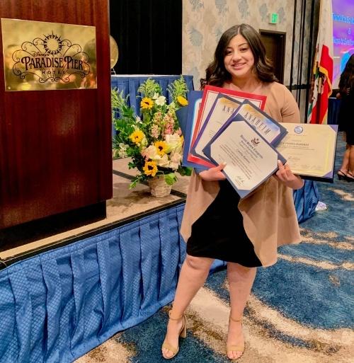 Cynthia Ramirez holding certificate