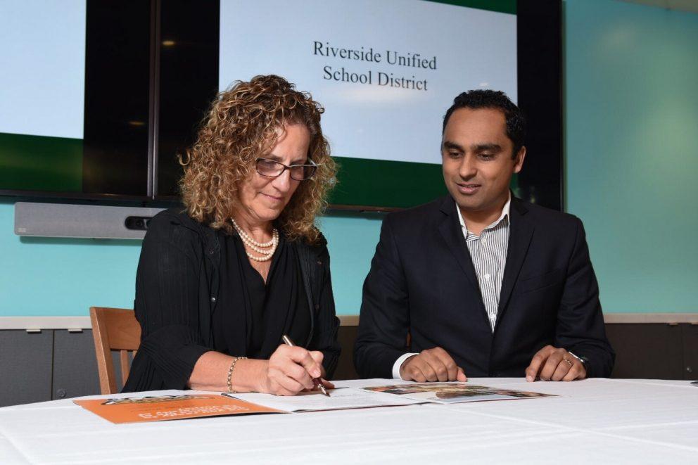 University President Devorah Lieberman with Riverside Unified representative