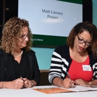 University President Devorah Lieberman with Math Literacy Project representative
