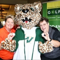 Mascot with golfers
