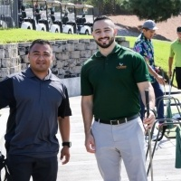 Golfers smiling
