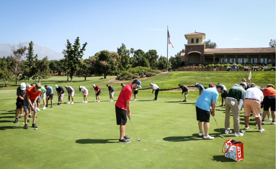 Golfers practicing