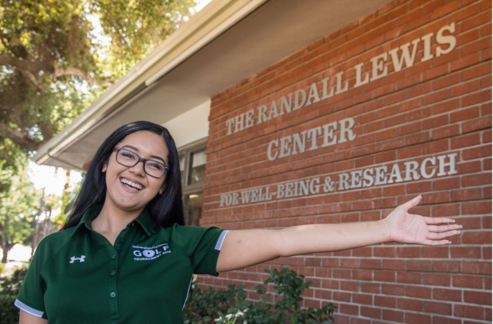 Student in front of Randall Lewis Center