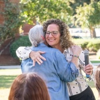 Devorah Lieberman hugging an attendee