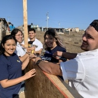 Students building a fence