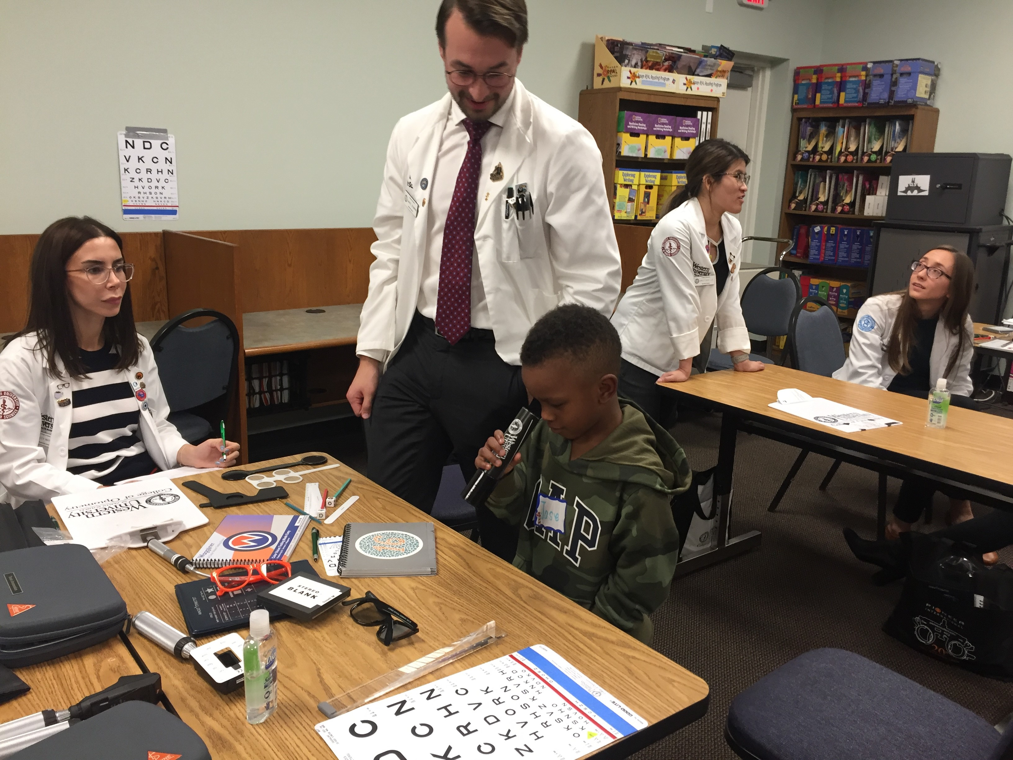 Student participating in vision screening