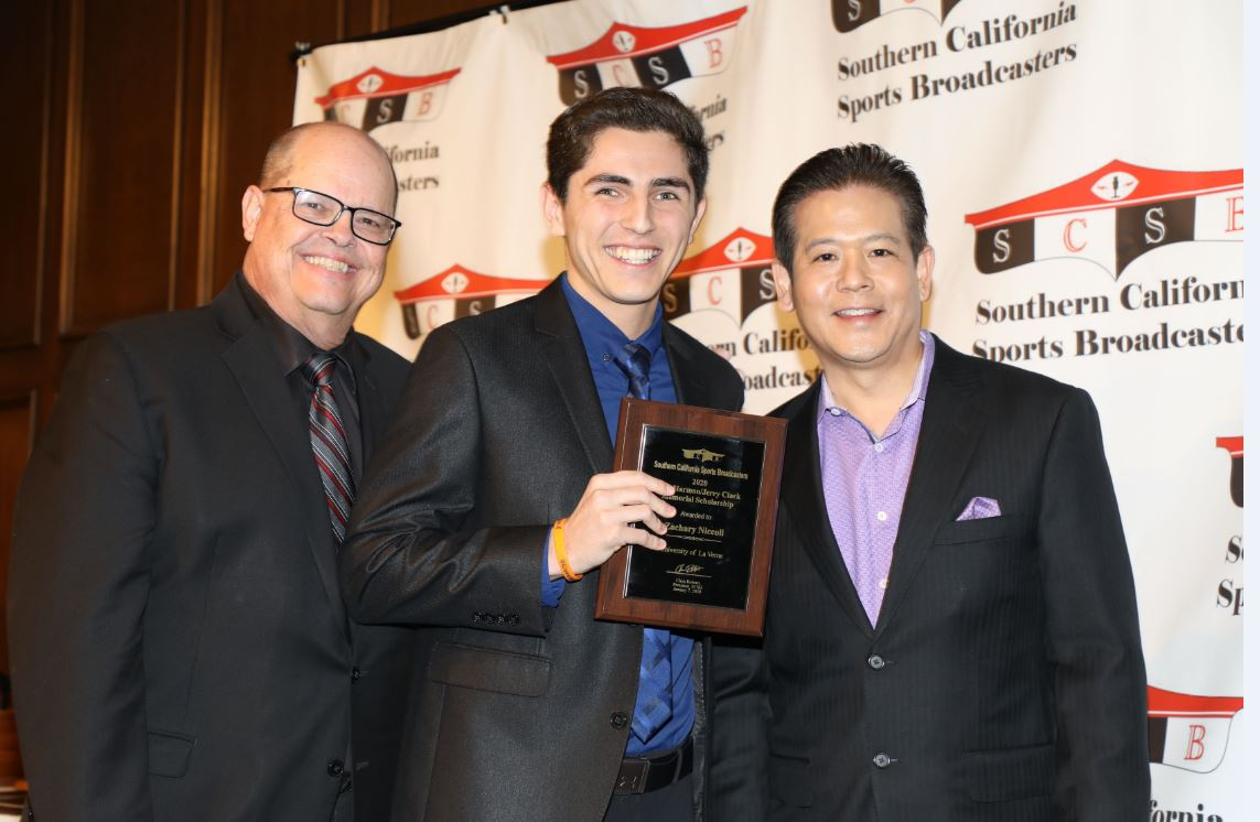 Zachary being presented with award