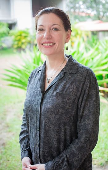 Emmeline de Pillis standing outside; headshot